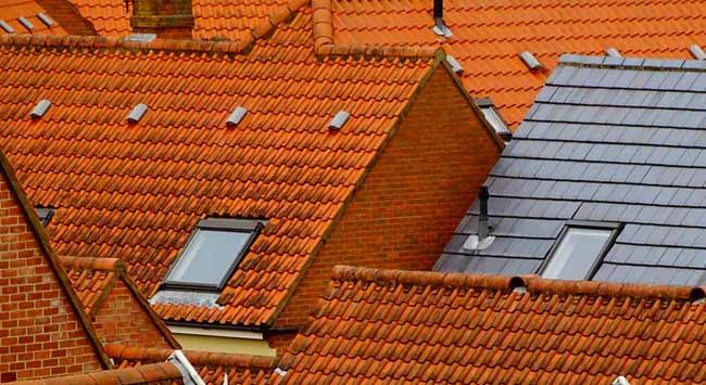 Wat zijn de kosten van het vervangen van een schuin dak